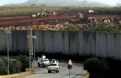 UN peacekeepers patrol the border wall separating Lebanon from Israel on December 9, 2018, after the Israeli army said it had uncovered Hezbollah infiltration tunnels underneath