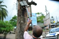Sarder removes billboards, thick nails and spikes from abused trees across the country