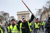 Yellow vest protestors begin gathering on the Champs Elysees in Paris