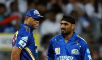 Andrew Symonds (left) and Harbhajan Singh became teammates at the Mumbai Indians three years after 'monkeygate' erupted