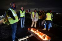 The French government is looking to end the 'ytellow vest' protests but arson attacks continued overnight with two more motorway toll stations set on fire in southern France, near Beziers and Manosque