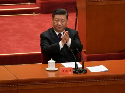 China's President Xi Jinping vowed to press ahead with economic reforms but made clear that Beijing will not deviate from its one-party system or take orders from any other country