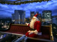 Against a backdrop of Kuala Lumpur's skyscrapers and in tropical heat, Santa in the Sky is a sleigh-like restaurant