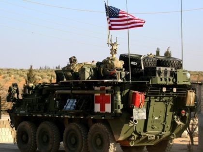 US forces with armored vehicles have been supporting the fight against IS in Syria
