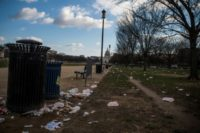 Litter spills out of a public dustbin on the National Mall in Washington as the US government shutdown goes into its third day