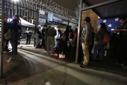 Asylum seekers stake claims on patch of US soil at border