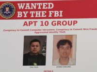 A poster displayed during a news conference at the Department of Justice in Washington, Thursday, Dec. 20, 2018, shows two Chinese citizens suspected to be with the group APT 10 carrying out an extensive hacking campaign to steal data from U.S. companies. The Justice Department is charging two Chinese citizens …