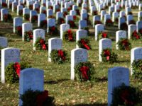 Wreaths grace headstones at Arlington National Cemetery as Wreaths Across America places remembrance wreaths on the nearly 245,000 headstones at the cemetery in Arlington, Va., Saturday, Dec. 16, 2017. (AP Photo/Cliff Owen)