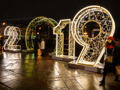 A woman walks in front of an illuminated '2019' sign on a square in central Moscow on December 30, 2018, ahead of the new year. (Photo by Mladen ANTONOV / AFP) (Photo credit should read MLADEN ANTONOV/AFP/Getty Images)