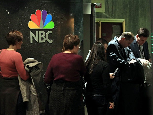 A tour group is searched before entering the studios at NBC headquarters in New York, Friday Aug. 21, 2009. Comcast Corp., a 1,200-subscriber cable system in Tupelo, Miss., is nearing a deal to control the NBC networks and the Universal movie studios. (AP Photo/Bebeto Matthews)