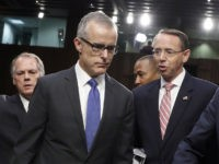 Jim Wolfe, committee staff member, helps direct FBI acting director Andrew McCabe, left, Deputy Attorney General Rod Rosenstein, and Director of National Intelligence Dan Coats to their seats for a Senate Intelligence Committee hearing about the Foreign Intelligence Surveillance Act, on Capitol Hill, Wednesday, June 7, 2017, in Washington. (AP …