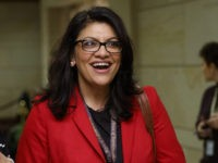 Rep.-elect Rashida Tlaib, D-Mich., right, walks with a reporter to a session during member-elect briefings and orientation on Capitol Hill in Washington, Thursday, Nov. 15, 2018. (AP Photo/Carolyn Kaster)