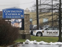 A police car sits at the entrance to Covington Catholic High School in Park Hills, Ky., Saturday, Jan 19, 2019. A diocese in Kentucky apologized Saturday after videos emerged showing students from the Catholic boys' high school mocking Native Americans outside the Lincoln Memorial on Friday after a rally in …