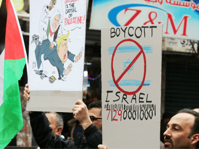 Jordanian protesters hold banners during a demonstration against the US president's decision to recognise Jerusalem as the capital of Israel, on December 29, 2017, in the Jordanian capital Amman. / AFP PHOTO / Khalil MAZRAAWI (Photo credit should read KHALIL MAZRAAWI/AFP/Getty Images) Editorial subscription SML 3460 x 2299 px | …