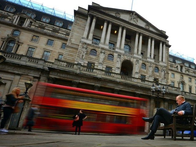 A man sits on a bench outside the Bank of England in London on October 25, 2012. Britain powered out of its longest double-dip recession since the 1950s after its economy returned to growth in the third quarter with a robust gain of 1.0 percent, official data showed. AFP PHOTO/BEN …