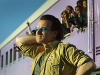 JOHANNESBURG, SOUTH AFRICA: Irish rocker Bono, lead singer of U2 is pictured at the Love Life Train in Soweto township 24 May 2002, outside Johannesburg. He was visiting the clinic that deals with AIDS related issues with the youth of Soweto. Bono is in the country on the second leg …
