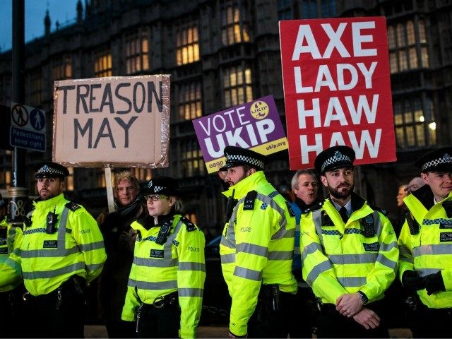 LONDON, ENGLAND - JANUARY 15: Police officers form a line as pro-Brexit protesters demonstrate outside the Houses of Parliament on January 15, 2019 in London, England. Theresa May's Brexit deal finally reaches the House of Commons this evening and MPs will begin voting on it at 7pm. The Prime Minister …