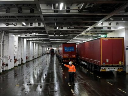 DOVER, ENGLAND - MARCH 05: Lorry drivers are guided as they board a ferry to Calais at the port of Dover on March 5, 2018 in Dover, England. The haulage industry faces an uncertain future while Brexit negotiations between the British government and the European Union continue. Many in the …