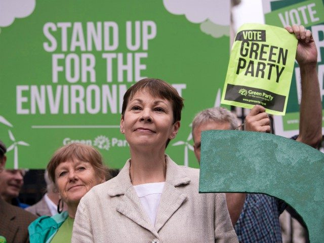 Green Party co-leader Caroline Lucas poses for a photograph with a green question mark outside the entrance to Downing Street in central London on May 30, 2017, during a general election campaign event to highlight the lack of debate by other political parties on environmental issues, as campaigning continues in …