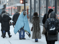 A homeless man bundles up in downtown Chicago. (AP Photo/Kiichiro Sato)