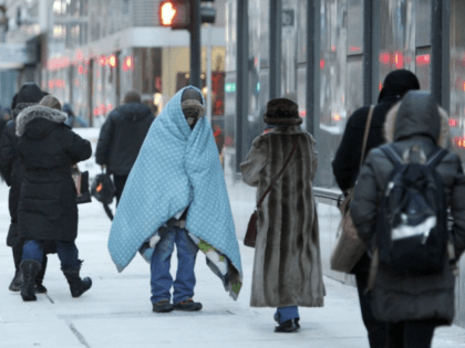 A homeless man bundles up in downtown Chicago. (AP Photo/Kiichiro Sato)