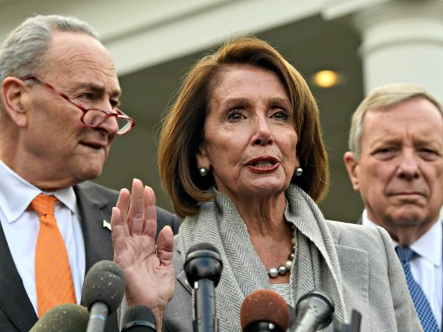 House Speaker Nancy Pelosi of Calif. center speaks about her oath of office as she stands next to Senate Minority Leader Sen. Chuck Schumer of N.Y. left and Sen. Dick Durbin D-Ill. right following their meeting with President Donald Trump at the Wh