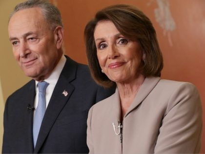 WASHINGTON, DC - JANUARY 08: Speaker of the House Nancy Pelosi (D-CA) and Senate Minority Leader Charles Schumer (D-NY) pose for photographs after delivering a televised response to President Donald Trump's national address about border security at the U.S. Capitol January 08, 2019 in Washington, DC. Republicans and Democrats seem …