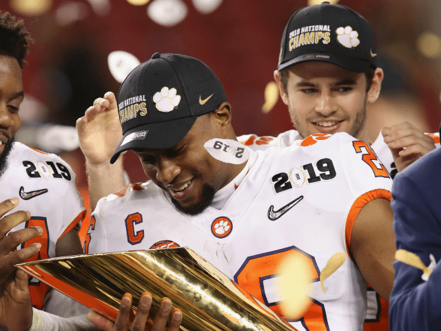 ANUARY 07: Adam Choice #26 of the Clemson Tigers celebrates his teams 44-16 win over the Alabama Crimson Tide with the trophy in the CFP National Championship presented by AT&T at Levi's Stadium on January 7, 2019 in Santa Clara, California. (Photo by Christian Petersen/Getty Images)
