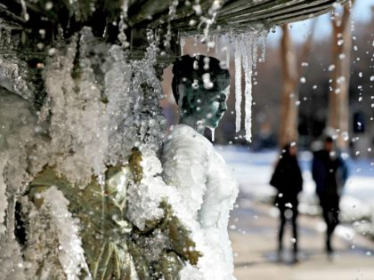 A water fountain freezes in the cold weather in Atlanta, Wednesday, Jan. 17, 2018. The South awoke on Wednesday to a two-part Arctic mess. First came a thin blanket of snow and ice, and then came the below-zero wind chills and record-breaking low temperatures in New Orleans and other cities.