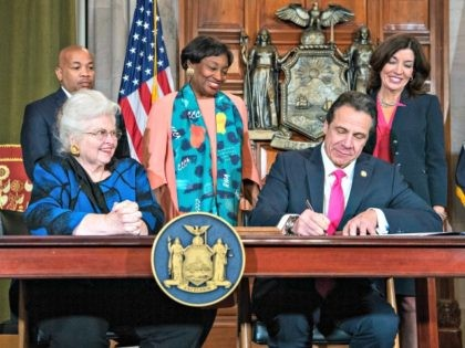 In this photo provided by the Office of Gov. Andrew M. Cuomo, Cuomo, right, signs Reproductive Health Act Legislation during a ceremony, Tuesday, Jan. 22, 2019, in the Red Room at the State Capitol in Albany, N.Y. With the new law, New York state enacts one of the nation's strongest …
