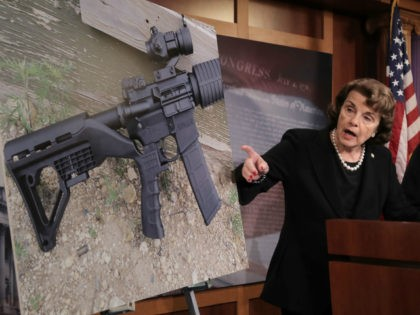 Sen. Dianne Feinstein (D-CA) (C) and Sen. Richard Blumenthal (D-CT) points to a photograph of a rifle with a 'bump stock' during a news conference to announce proposed gun control legislation at the U.S. Capitol October 4, 2017 in Washington, DC. In reaction to Sunday's mass shooting in Las Vegas …