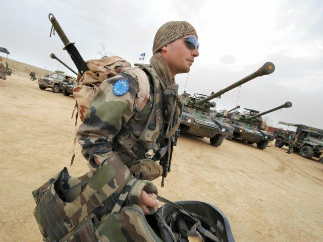 A French soldier of the European Union peacekeepers carries his gears as he walks into Farchana camp, East of Chad after returning from patrol on June. 27, 2008 where EUFOR contingent have deployed to secure refugees camps and protect local population from attacks by different local militiamen. The mainly French …