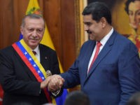 Venezuelan President Nicolas Maduro (R) and Turkish President Recep Tayyip Erdogan are pictured at Miraflores Presidential Palace in Caracas, on December 3, 2018.