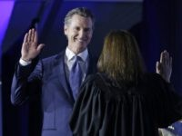 Gavin Newsom swearng in (Rich Pedroncelli / Associated Press)