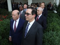 WASHINGTON, DC - JULY 25: Members of U.S. President Donald Trump's cabinet, including Treasury Secretary Steve Mnuchin (R) and Commerce Secretary Wilbur Ross (L) listen as Trump and European Commission President Jean-Claude Juncker deliver a joint statement in the Rose Garden of the White House to deliver a joint statement …