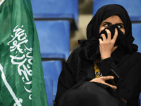 Saudi women cheer for their football team during a friendly match between Saudi Arabia and Iraq for the 'Superclassico' championship at King Saud University Stadium in Riyadh on October 15, 2018. (Photo by FAYEZ NURELDINE / AFP) (Photo credit should read FAYEZ NURELDINE/AFP/Getty Images)