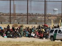 Nearly 150 Central American migrants seeking political asylum in the United States are detained by the Border Patrol, after entering the US through the Rio Grande, along the border with Ciudad Juarez, Chihuahua state, Mexico, on December 3, 2018. - Thousands of Central American migrants, mostly Hondurans, have trekked for …