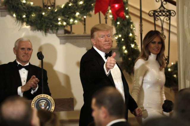 WASHINGTON, DC - DECEMBER 15: U.S. President Donald Trump with First Lady Melania Trump and Vice President Mike Pence (L) greet guests at the Congressional Ball at White House in Washington on December 15, 2018. (Photo by Yuri Gripas-Pool/Getty Images)