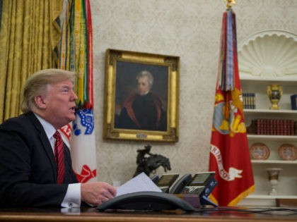 U.S. President Donald Trump makes a video call to service members from the Army, Marine Corps, Navy, Air Force, and Coast Guard stationed worldwide in the Oval Office at the White House December 25, 2018 in Washington, DC. (Photo by Zach Gibson-Pool/Getty Images)