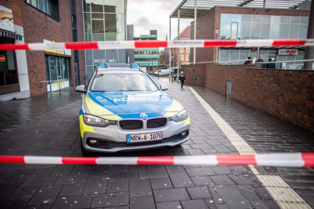 A picture taken on January 1, 2019 in Bottrop shows a police car in a cordoned off area at the site where a man injured four people after driving into a group celebrating the new year, in what police described as an anti-migrant attack. - The incident took place a …