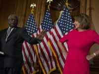 WASHINGTON, DC - JANUARY 03: House Majority Whip Jim Clyburn (D-SC) speaks to House Speaker Nancy Pelosi (D-CA) during a ceremonial mock swearing in ceremony on Capitol Hill on January 3, 2019 in Washington, DC. Under the cloud of a partial federal government shutdown, Pelosi reclaimed her former title as …