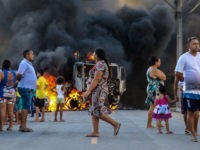This picture released by O Povo shows a truck burning during a wave of gang violence in Brazil's northeastern Ceara state, in the Conjunto Palmeiras neighborhood, city of Fortaleza, Ceara state, Brazil on January 3, 2019. - Brazil's government ordered troops to the northeast of the country on Friday to …