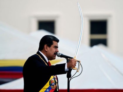 Venezuela's President Nicolas Maduro brandishes a sabre while delivering a speech during the ceremony of recognition by the Bolivarian National Armed Forces (FANB), at the Fuerte Tiuna Military Complex, in Caracas on January 10, 2019. - Maduro begins a new term that critics dismiss as illegitimate, with the economy in …