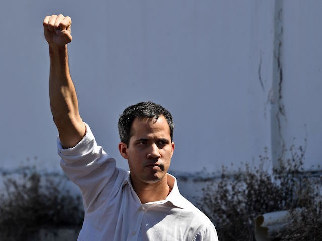 Venezuela's National Assembly president Juan Guaido gestures before a crowd of opposition supporters during an open meeting in Caraballeda, Vargas State, Venezuela, on January 13, 2019. - The president of the opposition-controlled but sidelined National Assembly was released less than an hour after being arrested by Venezuelan intelligence agents on …