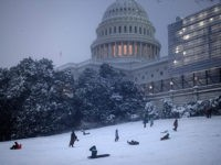 People sled on Capitol Hill during a winter storm January 13, 2019 in Washington, DC. - Washington area residents woke up to a winter wonderland, and may need to shovel aside several inches of snow that fell overnight as a winter storm warning remains in effect until 6 p.m. Sunday …