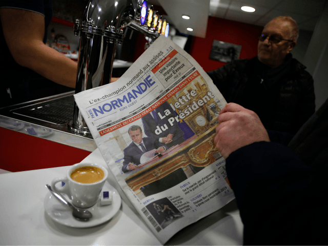 A resident of Bourgtheroulde-Infreville reads on January 14, 2019 a newspaper whose front page reads 'The President's Letter' (referring to 'the Letter to the French People' (Lettre aux Francais) written by French President Emmanuel Macron) in a bar in Bourgtheroulde-Infreville, northwestern France, ahead of the start of a two-month national …
