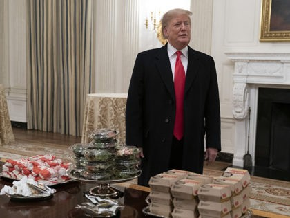 WASHINGTON, DC - JANUARY 14: U.S. President Donald Trump presents fast food to be served to the Clemson Tigers in celebration of their national championship at the White House on January 14, 2019 in Washington, DC. Clemson won their second title in three years after beating Alabama 44-16 on January …