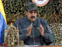 "This picture released by Miraflores presidential palace press office shows Venezuela's President Nicolas Maduro delivering a speech during a meeting in the framework of the preparations for the Bicentennial Angostura Congress and the Military Exercise ""Soberania 2019"" at the Fuerte Tiuna Military Complex, in Caracas on January 15, 2019. (Photo …"