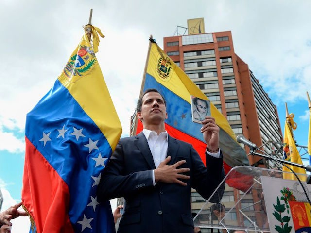 "Venezuela's National Assembly head Juan Guaido declares himself the country's ""acting president"" during a mass opposition rally against leader Nicolas Maduro, on the anniversary of a 1958 uprising that overthrew military dictatorship in Caracas on January 23, 2019. - Moments earlier, the loyalist-dominated Supreme Court ordered a criminal investigation of …"