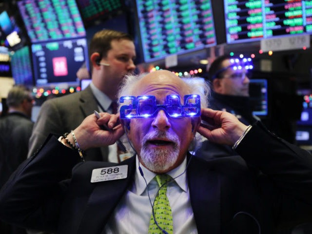 NEW YORK, NEW YORK - DECEMBER 31: Traders work on the floor of the New York Stock Exchange (NYSE) on the last day of the trading year on December 31, 2018 in New York City. Despite a continued strong economy and low unemployment, 2018 proved to be a volatile year …